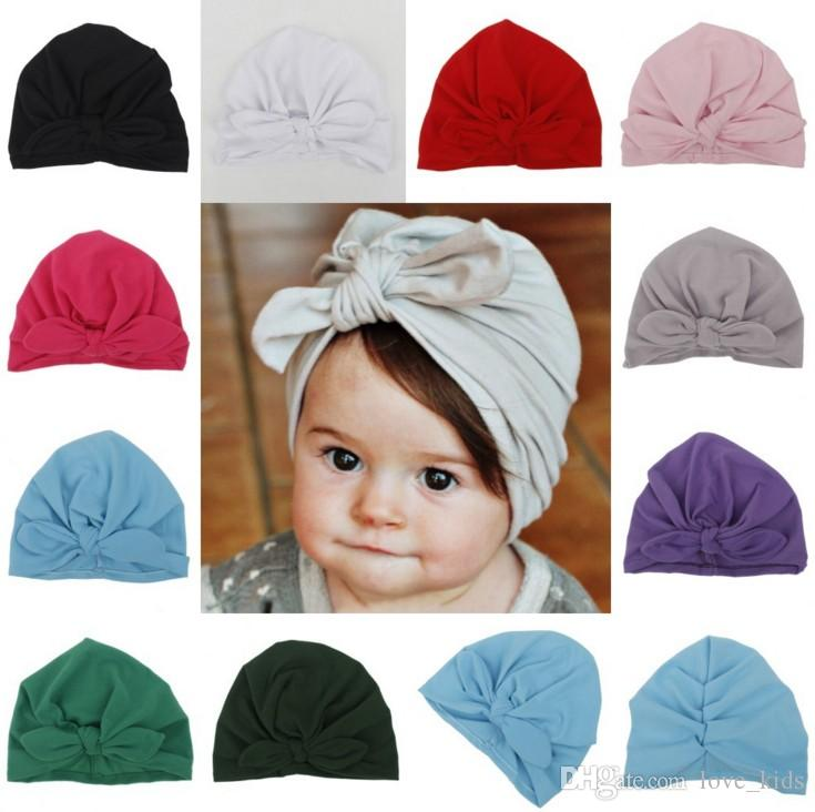 7f4f24670e8 Bow Baby Hat Cotton Spring Autumn Girls Boys Cap Bohemia Style Kids Hats  Newborn Photography Props Caps Accessories UK 2019 From Love kids