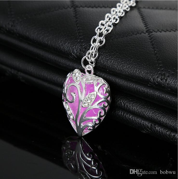 European and American men and women fashion jewelry heart pendant necklace love the night light emitting luminous pendant hollow