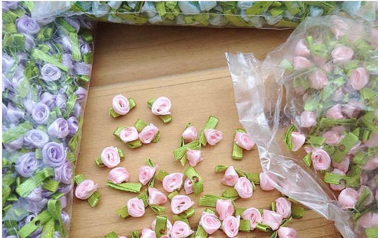 Comercio al por mayor hecho a mano material de bricolaje flor de la cinta de la muñeca flores decorativas caja de dulces accesorios de regalo de embalaje