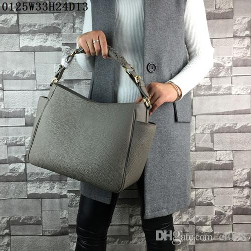 Latest women leather totes Lichee grain Medium casual bags humany sides pockets designment Urban casual women fashion bags near cost price