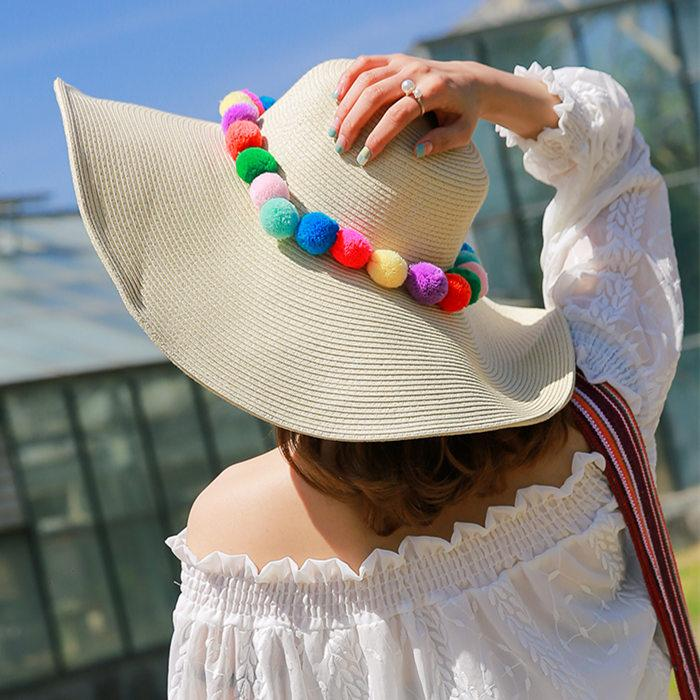 Wide brim sun hat with pom pom sun protection straw beach caps available