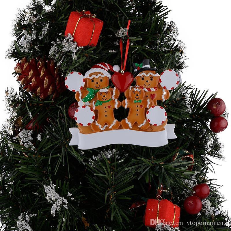 Großhandelsharz-Lebkuchen-Familie von 4 Weihnachtsverzierungen mit rotem Apple als personalisierte Geschenke für Feiertag