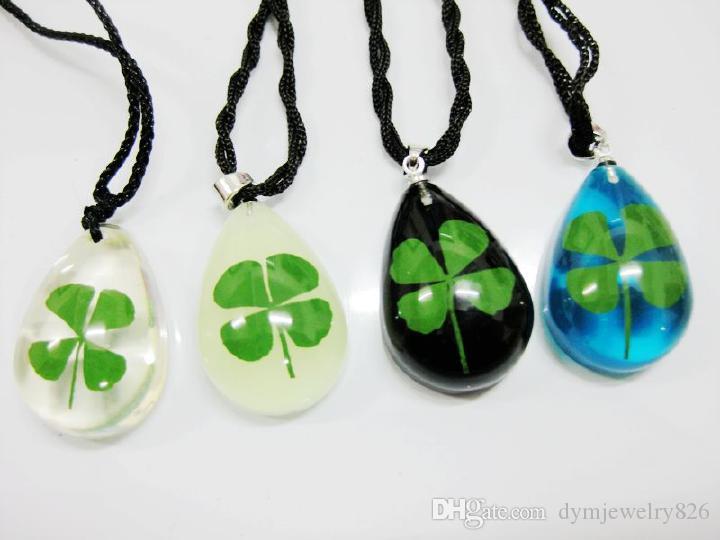 Livraison gratuite yqtdmy 12 pendentif incorporé trèfle à quatre feuilles lueur lucide bleu goutte noire pendentif souvenir