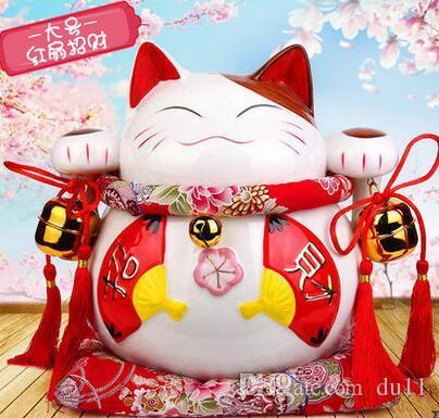 Il gatto è un deposito di scatole di ceramica giapponese dorato e grande che apre regali creativi