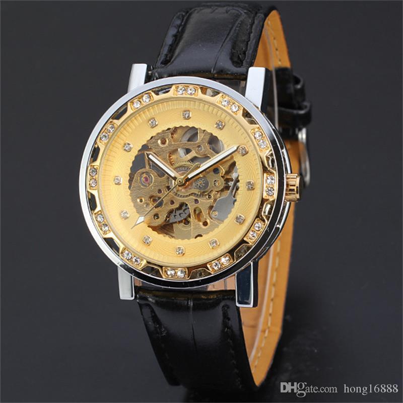 Ganador de la moda Banda de cuero negro Reloj mecánico esqueleto de acero inoxidable para hombre / mujer Reloj de pulsera mecánico de oro Envío gratis