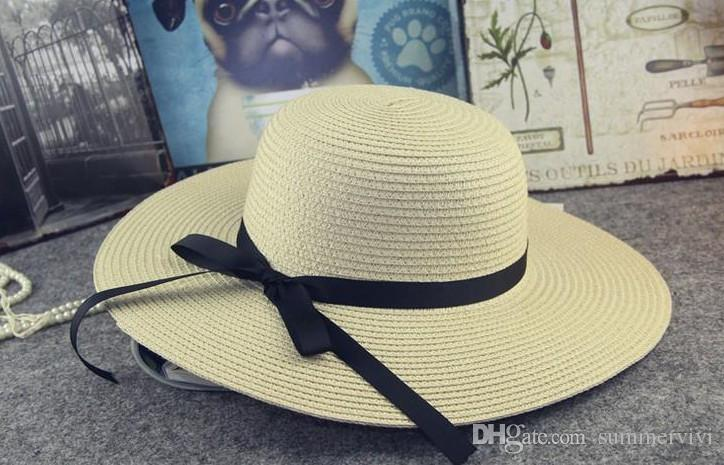 Summer Girls Grass Braid Cappelli Bambini Arco Ribbon Beach Cap Bambini Hollowed-out Sunhats Baby Fashion Cappello Paglia Bows A9296