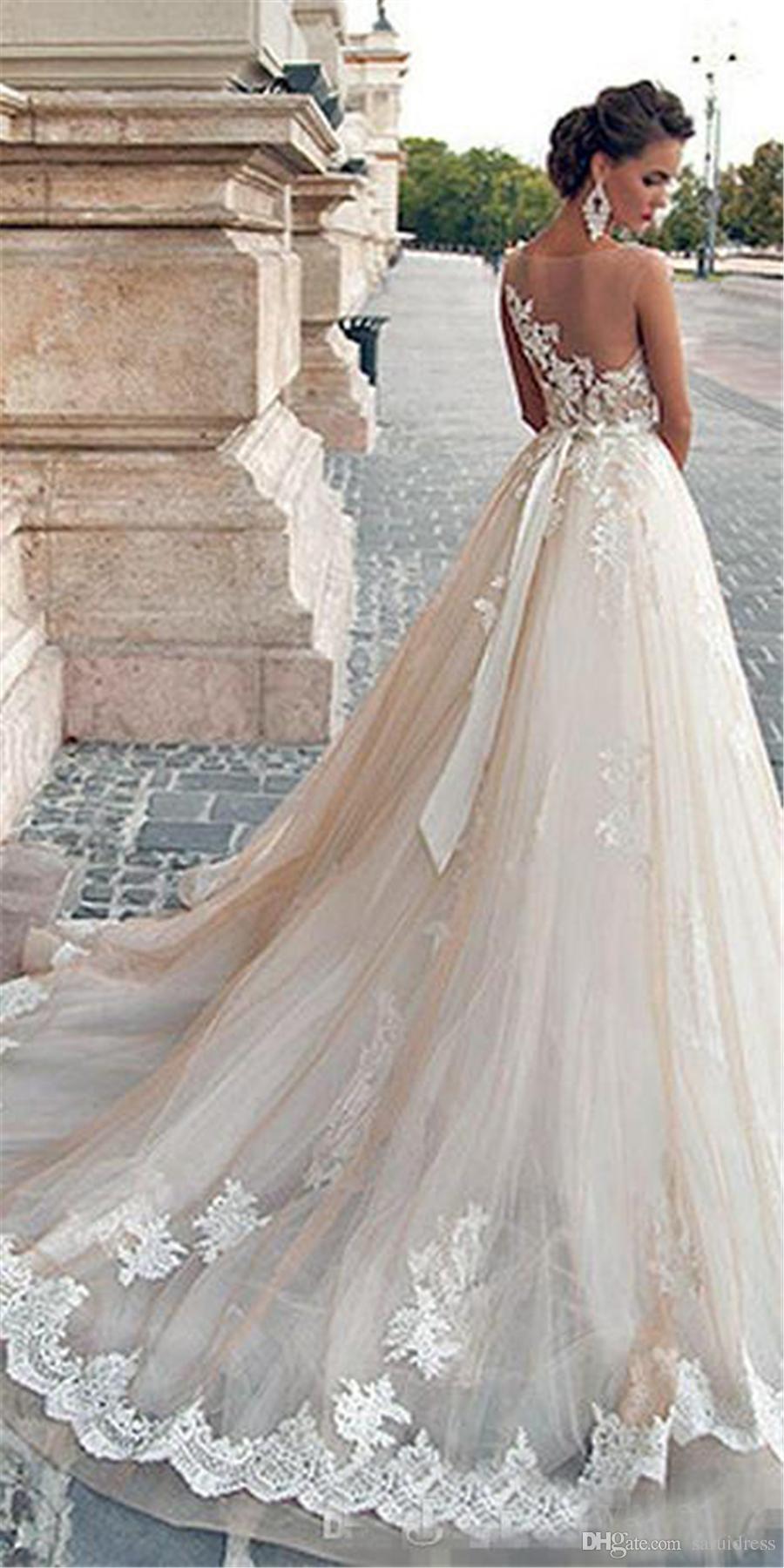 Illusion Décolleté Dentelle Perles Sexy Back Modest Plus Size Robes de mariée Vintage Mila Nova Champagne Princesse Robes de Mariée