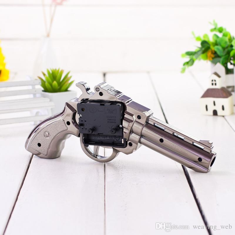 2019 sveglia novità girevole pistola pistola bambini sveglia missile pistola a mano mini carino orologio d'argento la decorazione domestica buon regalo bambino