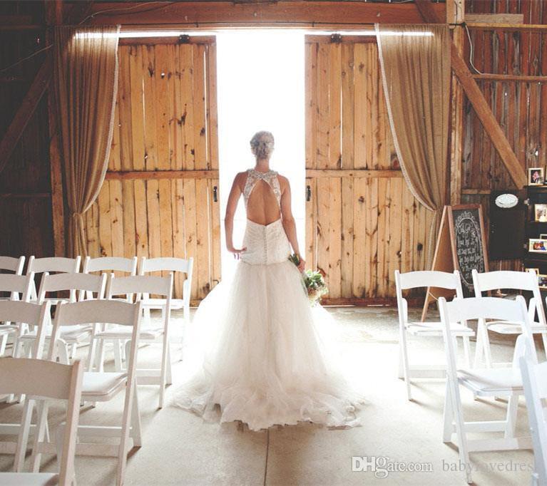 Maßgeschneiderte Perlen Neckholder ärmellose Spitze Brautkleider öffnen zurück Sweep Zug Tüll Meerjungfrau Brautkleider
