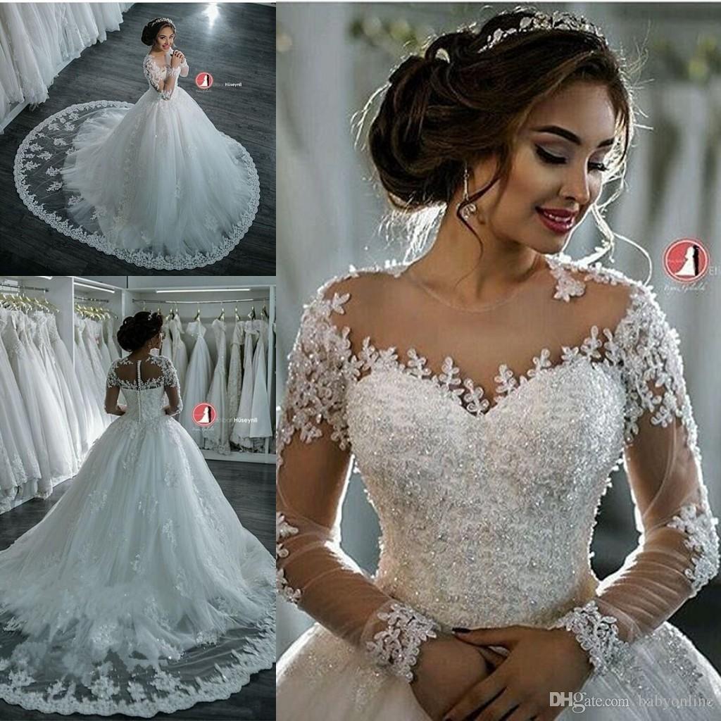 2020 새로운 두바이 우아한 긴 소매 A 라인 웨딩 드레스 쉬어 크루 넥 레이스 아플리케 구슬 Vestios 드 노비 신부 가운 버튼