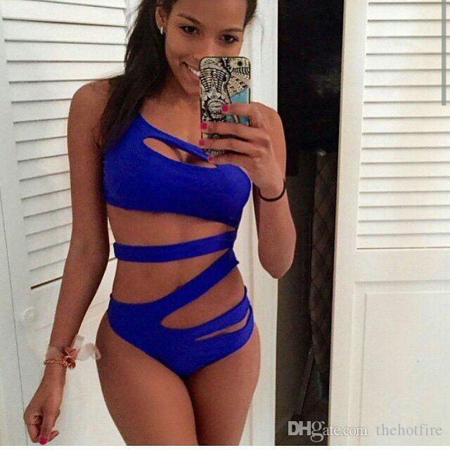90cfffdb253 2019 2016 Sexy One Piece Suit Women Hollow Out Solid Swimsuit Blue Black  White Beach Bathing High Cut One Shoulder Bandage Swimwear From Thehotfire