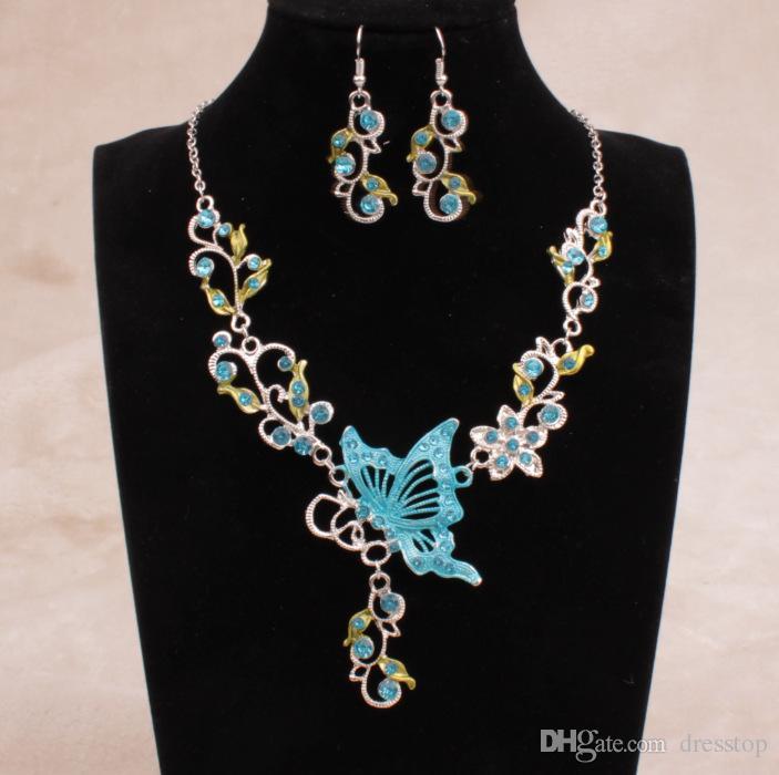 En stock es brillantes diamantes de imitación flores de mariposa nupcial dama de honor collar y pendientes fiesta de bodas conjunto de joyas baratas