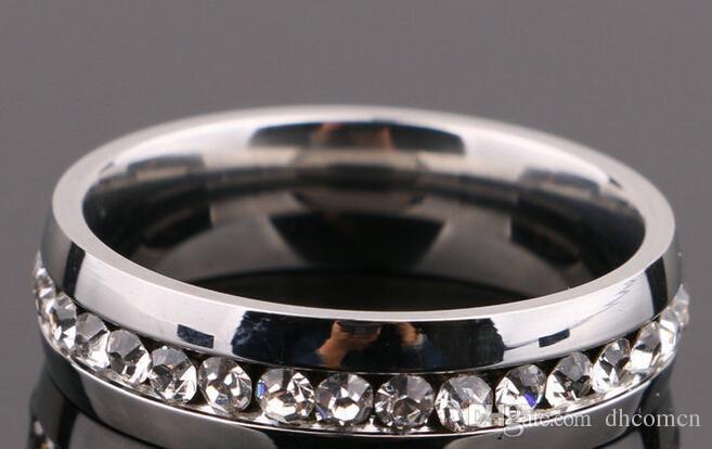 Le fedi nuziali di cristallo dell'acciaio inossidabile gli uomini delle donne che vendono il pacchetto europeo di vendita di stile di opp Dhl liberano il trasporto