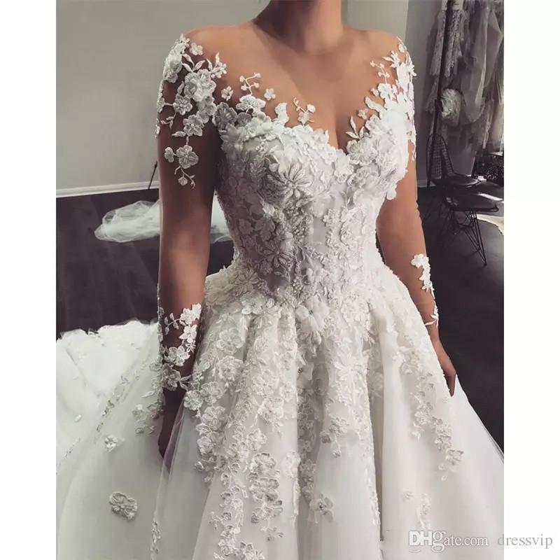 Abiti da sposa romantici in abito da ballo in pizzo Plus Size con maniche lunghe Abiti da sposa arabi Abito da sposa sexy Robe De Mariage 2018 a Dubai