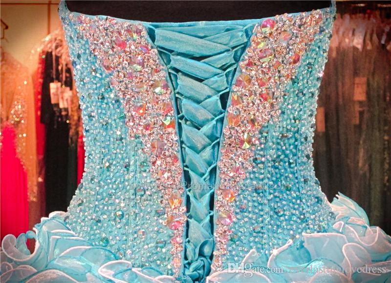 Vestido de quinceañera turquesa / blanco con volantes cariño escote con cordones Volver Bolero chaqueta Sexy vestido de dieciséis vestido del desfile