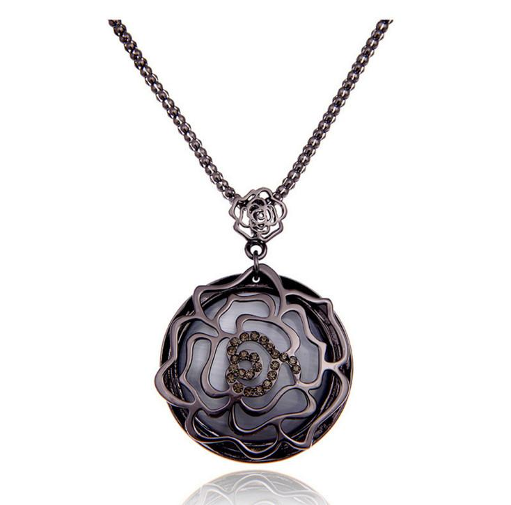 2016 autumn and winter new retro hollow rose inlaid cat's eye stone pendants sweater chain long fashion decorative necklace