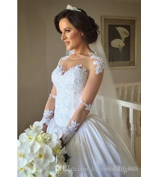 2019 Robes de mariée à manches longues en dentelle Appliques Illusion Fermeture à glissière Retour Ivoire Princesse Puffy Robes de mariée Aso Ebi Style Une robe de ligne