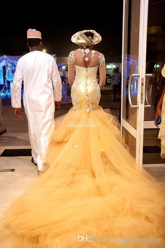 2021 Vestidos de novia tradicionales africanos Nigeria Vestidos de boda de oro Cuentas de cristal Tulle Tulle Mangas largas Sirena Vestido nupcial más tamaño