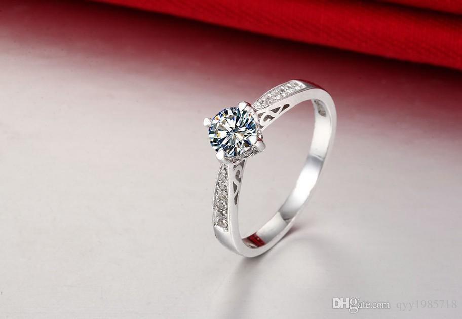 Großhandel Schmuck 0.5ct Hohl 4 Zinken SONA Simulieren Diamant Ring Verlobung Frauen Sterling Silber Schmuck 18 Karat Weißes Gold Überzogen