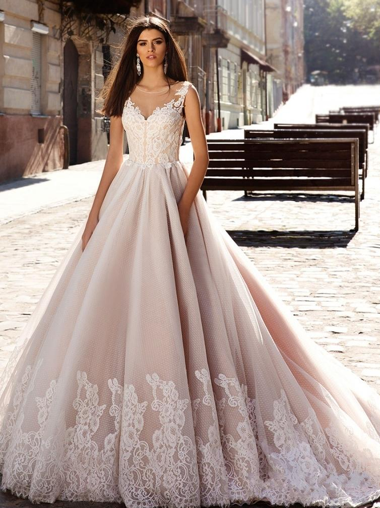 Nude pink princess ball gown wedding dresses illusion round nude pink princess ball gown wedding dresses illusion round neckline sheer v neck lace embellished back gorgeous bodice bridal gowns 2016 pink wedding dress junglespirit Gallery