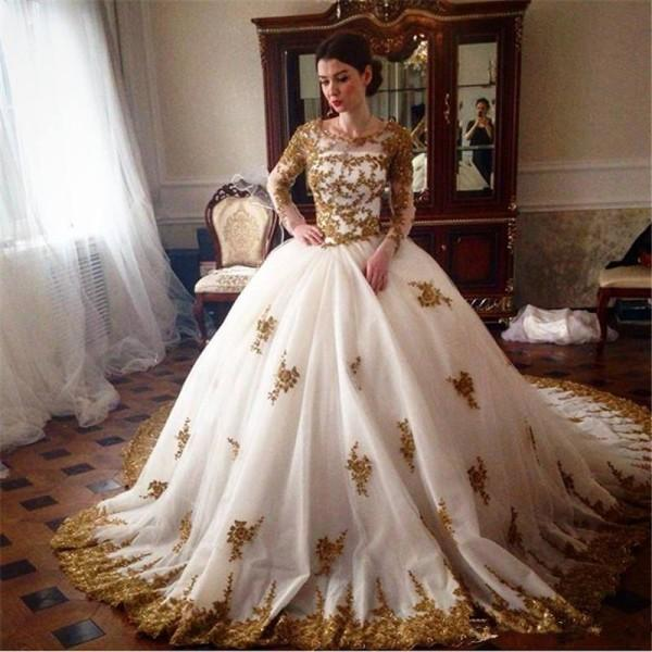 Sparkly Ball Gown Wedding Dresses Beaded Gold Lace Appliques Illusion Long Sleeves Crew Neck Zipper up Back Bridal Gowns with Court Train