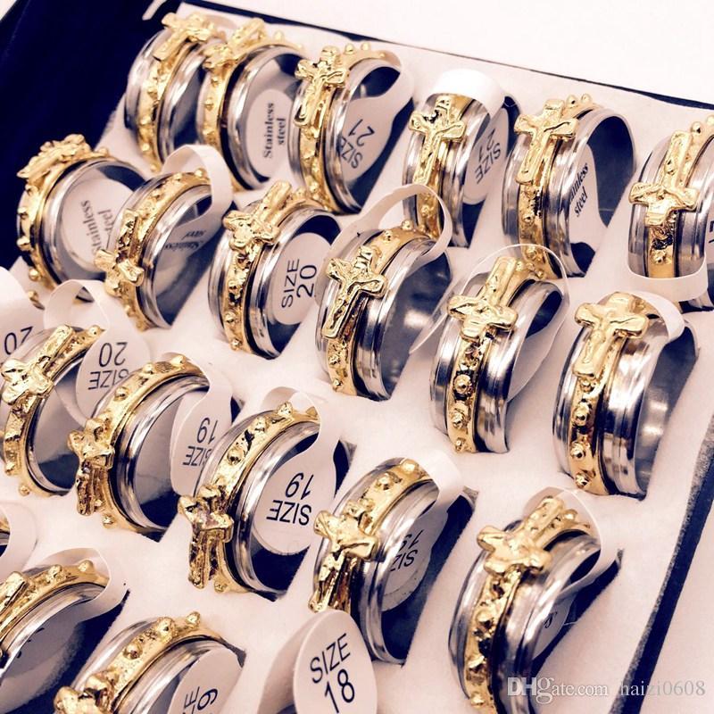 Venta al por mayor lotes oro Jesucristo cruz religión Mens acero inoxidable rotación anillos de la joyería