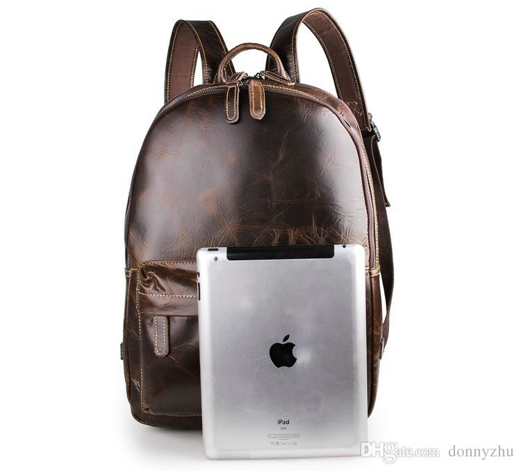 5635cdd0ce23 2019 Mens And Womens Genuine Leather Backpack Travel Bag 17 Laptop Mac Bag  Vintage Style Bag Black And Chocolate Color 7273 From Donnyzhu