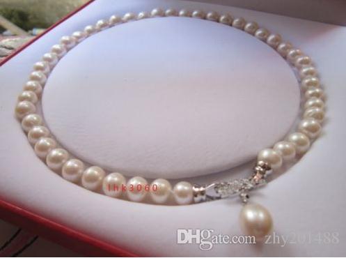 db80117a8448 Compre Collar De Perlas Naturales Blancas Del Mar Del Sur 10 11mm Colgante  Encantador Colgante De 18 Pulgadas   A  63.32 Del Zhy201488