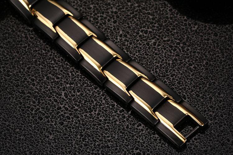 Hot Coulples Pulsera del amante de acero inoxidable chapado en oro negro Pulseras de eslabones de relojes con cuidado de la salud Pulsera de piedra magnética para hombres Damas