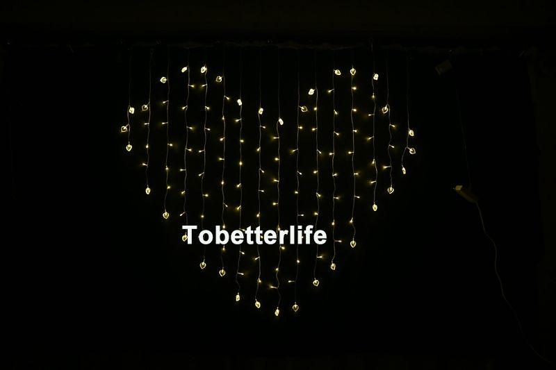 Luces de cortina led en forma de corazón Cadena de luz del corazón Colores Decoración de la boda Luces de cortina de hadas Navidad Xmax Party Decor 110 V 220 V
