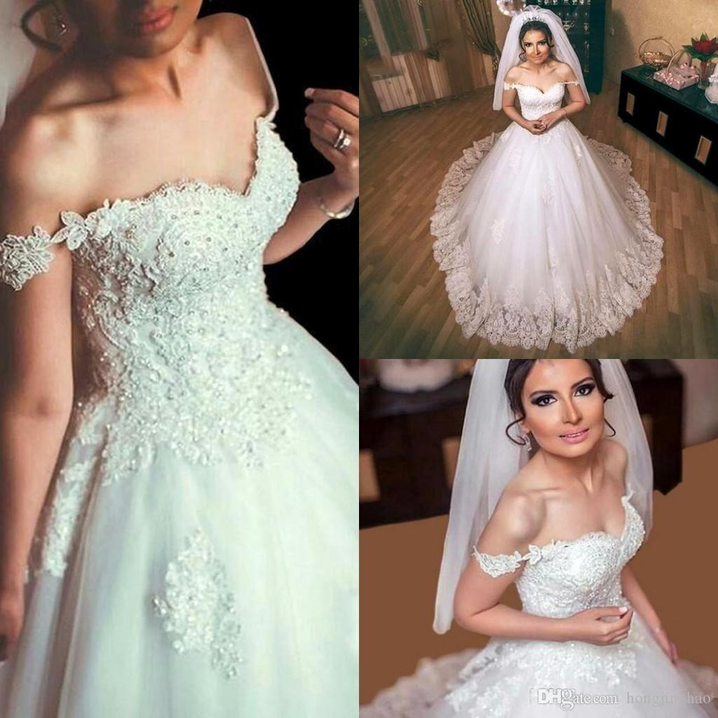 Discount 2017 Arabic A Line Wedding Dresses Sweetheart Off Shoulder Cap  Sleeves Lace Appliques Beaded Tulle Court Train Plus Size Formal Bridal  Gowns A Line ... c99e46f9e1a5