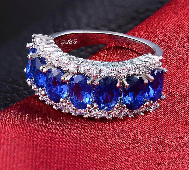 Gli anelli d'argento 925 liberi di trasporto placcati con i monili di cerimonia nuziale delle donne dell'anello di cristallo multicolore della caramella dell'oro 18K suona la vendita calda
