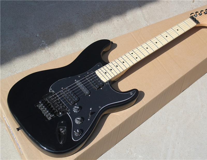 black electric guitar with black body and maple fretboard and floyd rose and can be changed. Black Bedroom Furniture Sets. Home Design Ideas