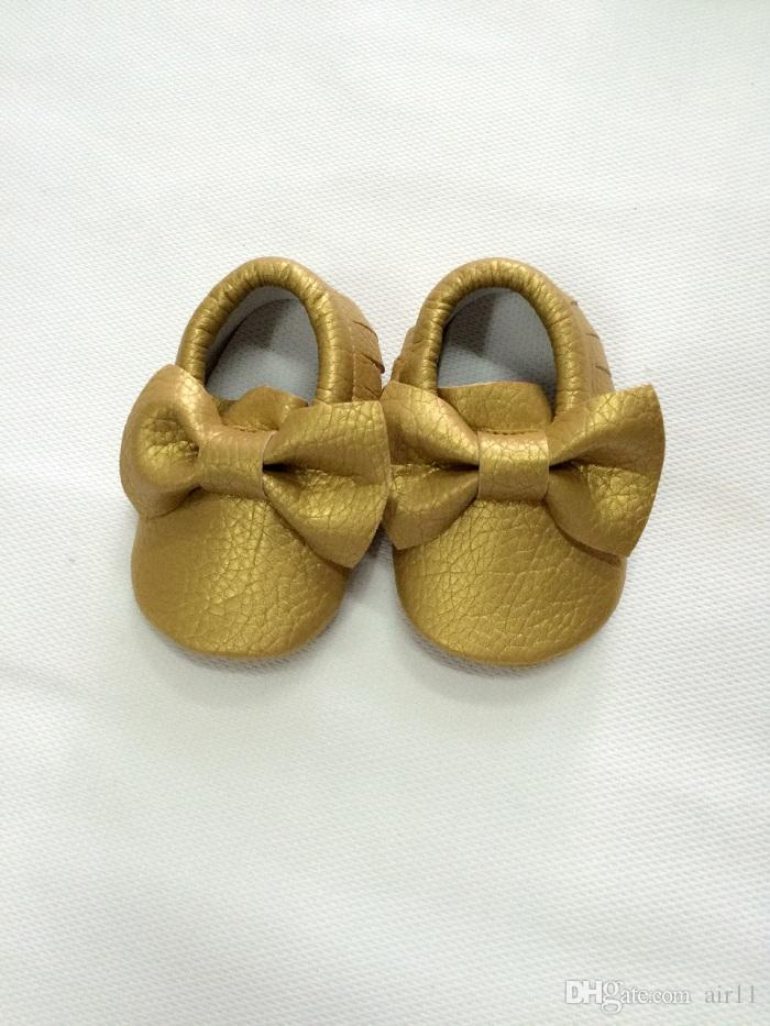 17 colores de alta calidad para niños pequeños mocasines al por mayor hecho por el hombre de cuero suave de la pu zapatos de Walker del bebé estilo de Europa Bowknot diseño zapatos de los bebés