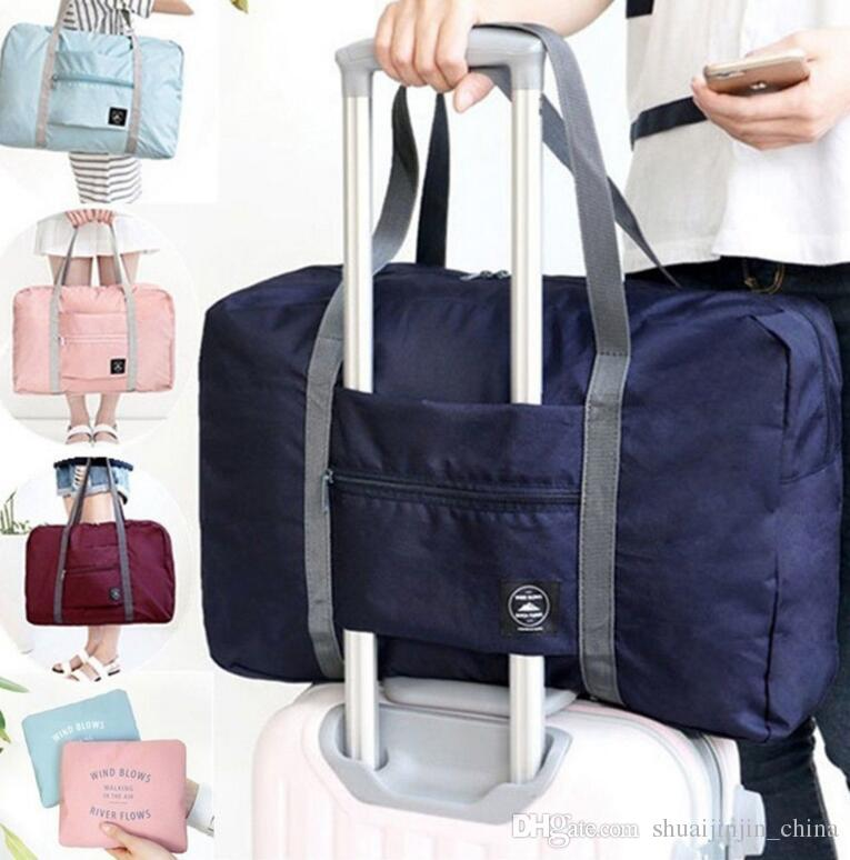 e45d3a80e9c Folding Travel Bag Travel Bags Hand Luggage For Men And Women New Fashion  Duffle Bag Travel Waterproof Pouch Tote Bag LJJK791