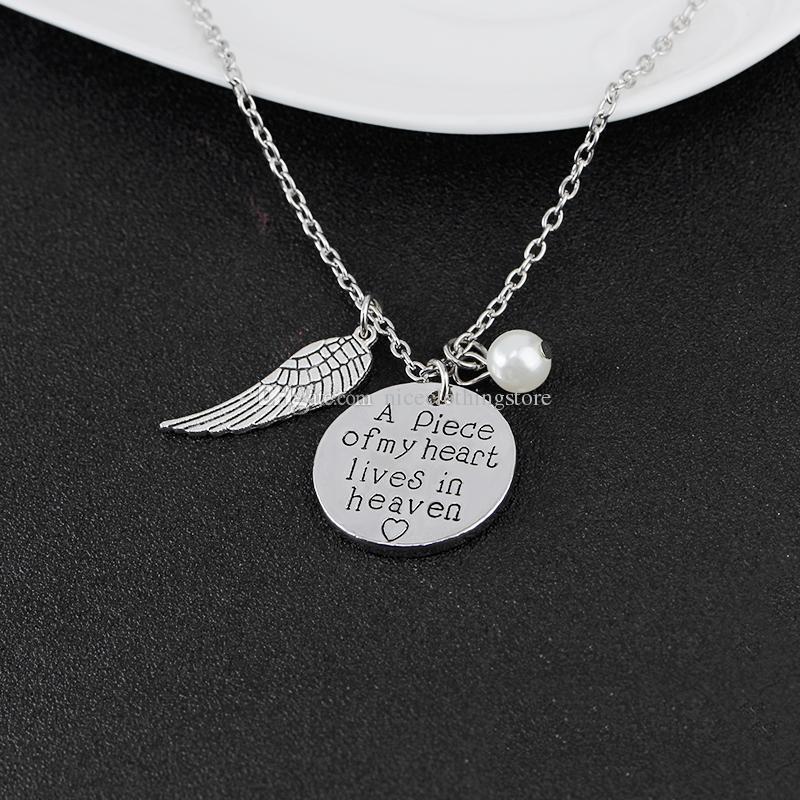 'Un morceau de mon coeur vit au paradis' Collier avec écriture personnalisée Collier du souvenir Mémoire Angel Wing Jewelry