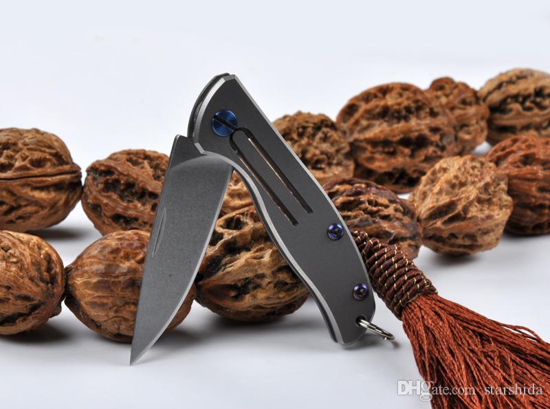 Nuevo D2 A1 Aleación de titanio Lavado a la piedra Cuchillo plegable táctico 59HRC Camping Caza Supervivencia Cuchillo de bolsillo Utilidad Llavero EDC Herramientas