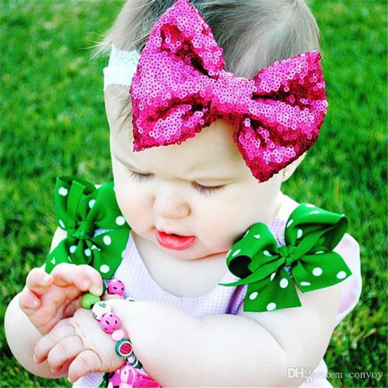 طفل الرباط عقال الفتيات الاطفال مرونة القوس رباطات مطرزة براق bowknot hairbands الأطفال اكسسوارات للشعر 12 ألوان KHA359