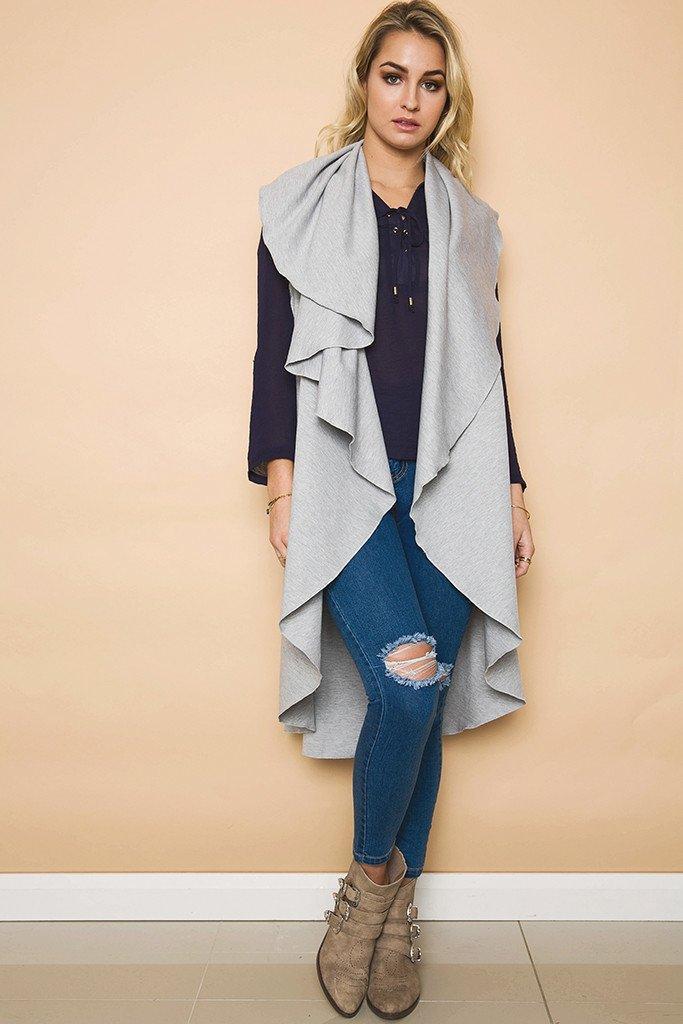 e55464d7db61f 2019 Women S Autumn Winter Plain Lapel Sleeveless Asymmetric Hemline Long Cardigan  Woolen Sweater Outfit Clothing Vestidos Size  S M L XL DY17704 From ...