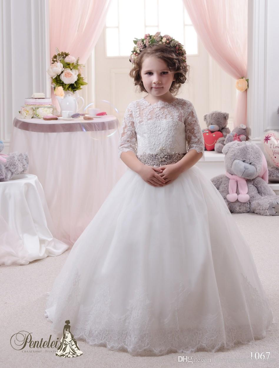 2016 Kids Wedding Dresses with Long Train and Half Sleeves Lace Appliques Beautiful Flower Girls Gowns with Beaded Sash and Bows