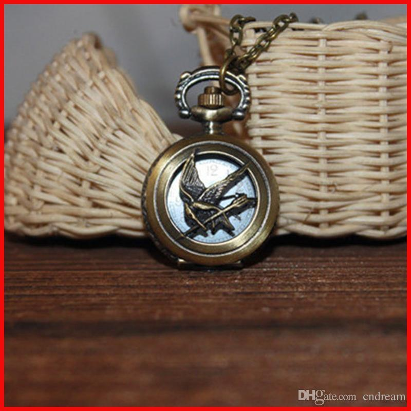Hunger games mockingjay necklace pocket watch bronze bird bow charm hunger games mockingjay necklace pocket watch bronze bird bow charm quartz watch fob watches necklaces men women charm jewelry 230152 pocket watch sales aloadofball Images