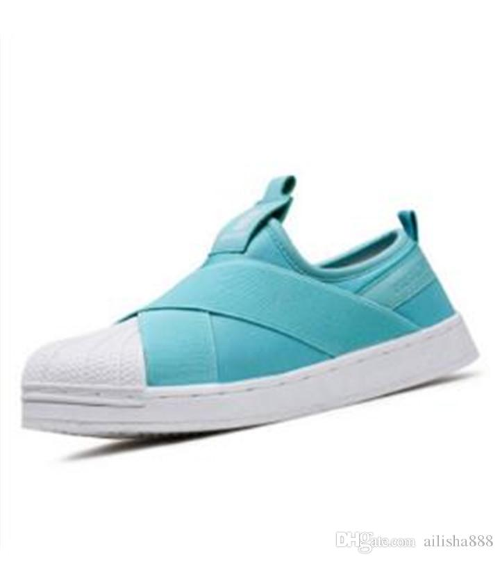 e9171e292d67 Rihanna Female Flat Cross Straps Shell Head Board Shoes Tide Men Wild Casual  Shoes Couple Men And Women Canvas Shoes 062 Red Shoes Footwear From  Ailisha888