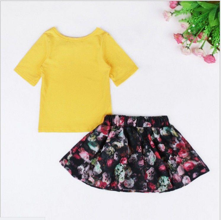 Słodkie dziewczyny Dwukierki Zestaw 2016 Lato Nowa Dziewczynka Żółta koszulka Topy + Kwiatowe Tutu Spódnice Moda Dzieci Garnituje Dzieci Casual Stroje