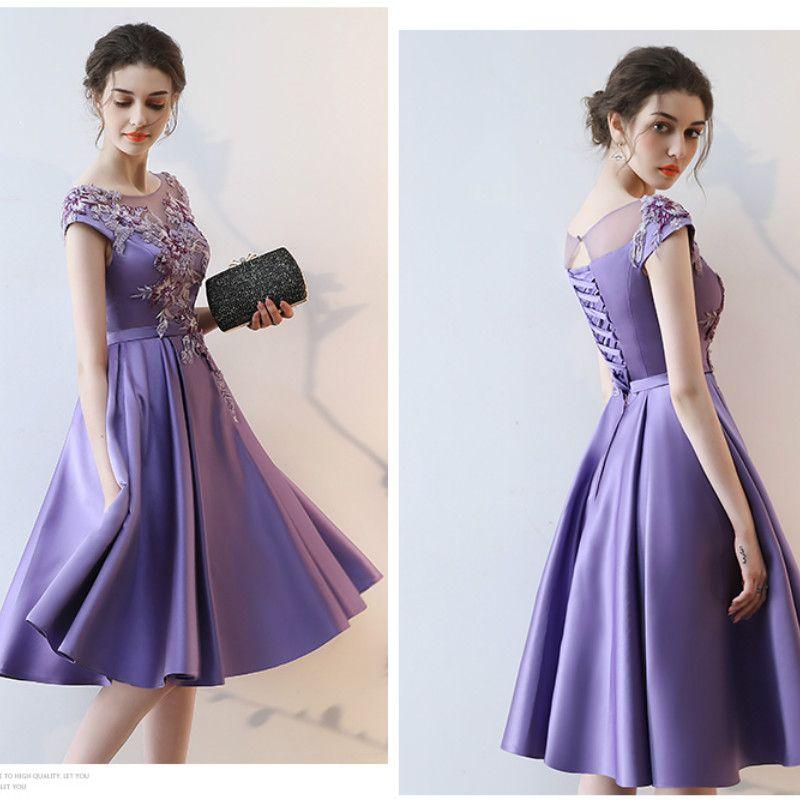 Scooped Necked Sleeveless Tea Length Dress
