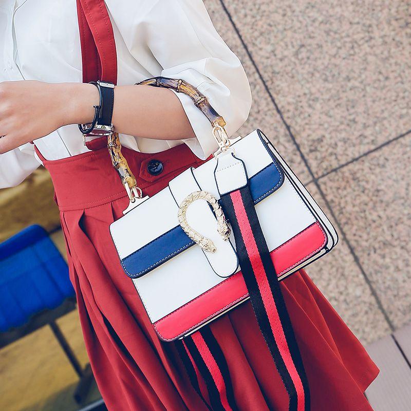 China Nueva marca Mujeres Pu Bolsos de cuero Señora Rayas Bolsa Casual Totalizador Bolsas de mensajero de moda Nuevo diseño Sac