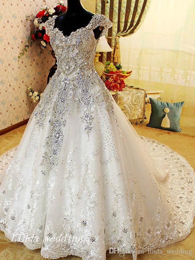 Luxury Crystal Beaded Wedding Dresses Romantic A Line Cap Sleeve Tulle Lace Applique Long Women Bridal Party Gowns