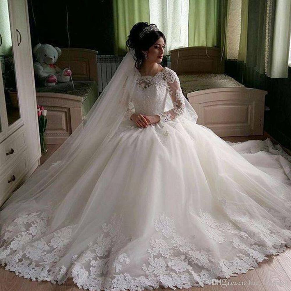 2017 Ball Gown Wedding Dresses with Jewel Neckline Lace Long Sleeves Sheer Neck Beaded Appliques Sequins Sweep Train Muslim Bridal Gowns