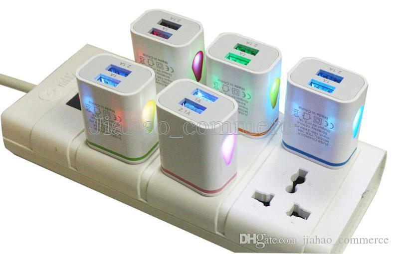 Encienda la gota de agua LED Puertos USB dobles Adaptador de corriente para viajes en el hogar 5V 2.1A + 1A EE. UU. Enchufe de pared de la UE para teléfonos inteligentes, tabletas para teléfonos móviles