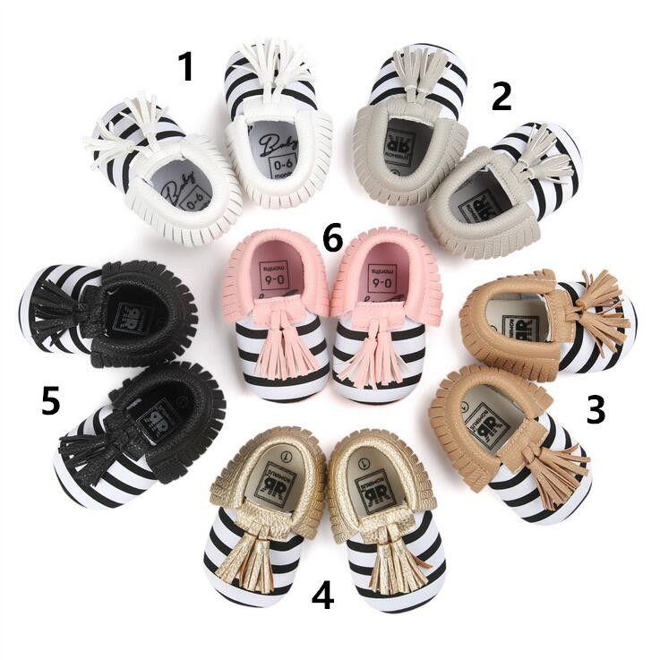 Nueva raya del otoño del resorte del bebé de los niños primeros zapatos del caminante borlas mocassions zapatos infantiles PU zapatos de suela blanda primeros caminante