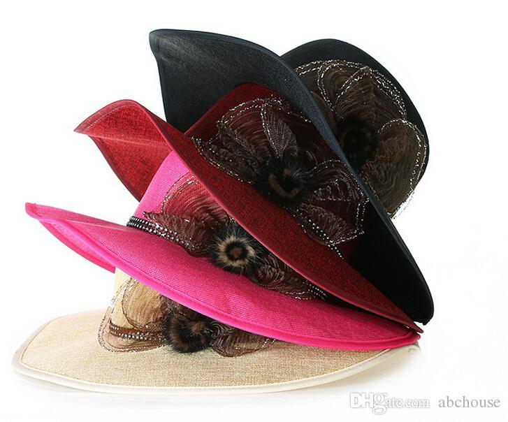 Le larghe cappelli di paglia estivi del bordo floreale delle donne di vendita calda progettano i cappucci increspati delle protezioni di usura della testa della spiaggia della spiaggia